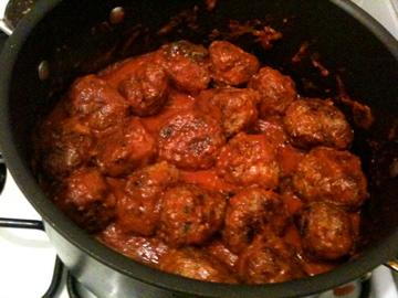 meatballs simmering in sauce